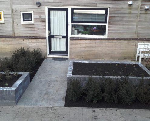 Aanleggen tuin met bloembakken